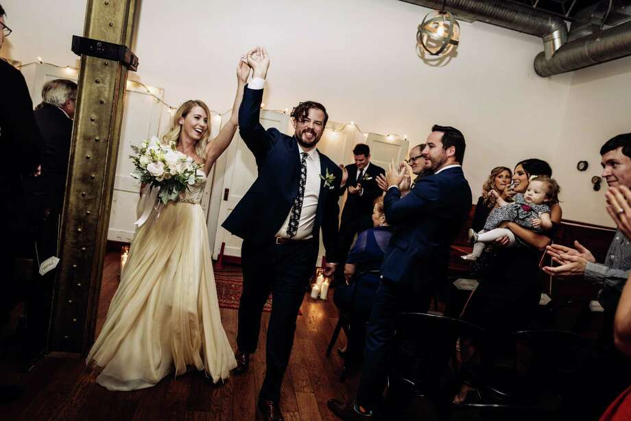 This Oct. 8, 2016 photo provided by Chondon Photography shows newly-married couple Heidi and Rob Cundari after their wedding, in Thunder Bay, Ontario, Canada. Selling your wedding dress used to be a social no-no. Heidi Cundari says she opted for a used dress to keep costs down. Photo: Chondon Photography Via AP  / Chondon Photography