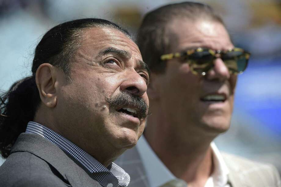 "FILE - In a Sunday, Sept. 25, 2016 file photo,  Jacksonville Jaguars owner Shad Khan, left, and Baltimore Ravens owner Stephen J. Bisciotti chat before an NFL football game in Jacksonville, Fla. Khan set the tone for the Jaguars season, saying a winning record was ""everybody's reasonable expectation, "" but the Jaguars (2-5) are among the NFL's biggest disappointments. (AP Photo/Phelan M. Ebenhack, File) Photo: Phelan M. Ebenhack / AP / FR121174 AP"