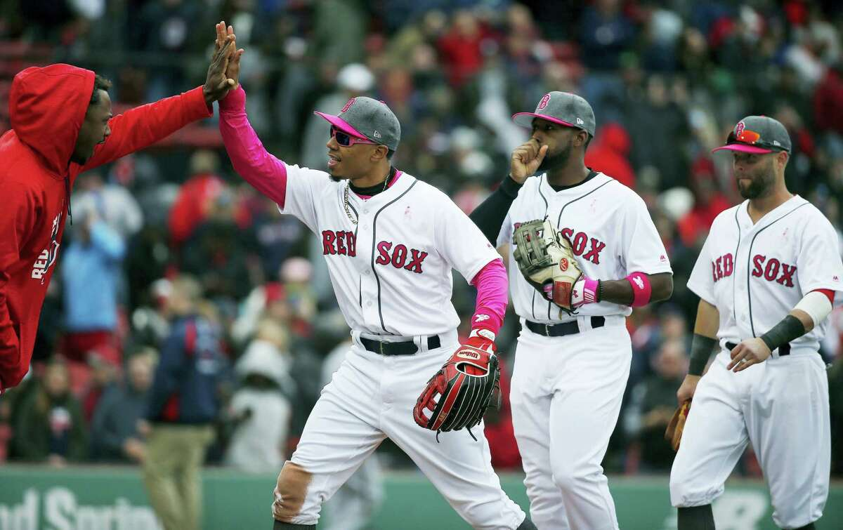 Mookie Betts, center, Jackie Bradley Jr., second from right, and Dustin Pedroia, right, celebrate after Saturday's win.