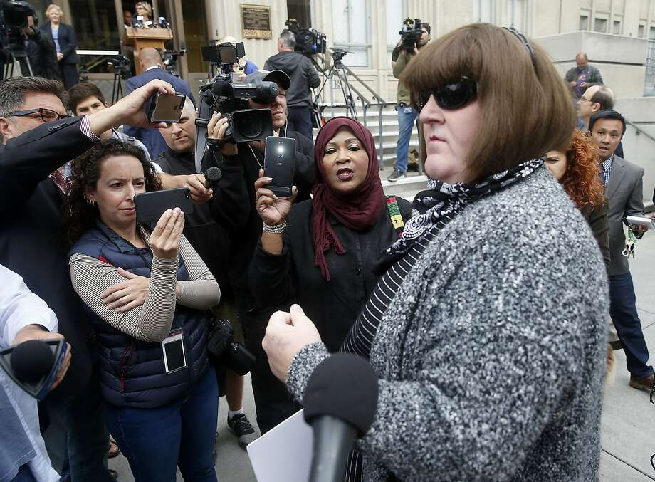 Amber Cummings speaks to reporters on the steps of City Hall in Berkeley, Calif., on Tuesday, Aug. 22, 2017, to discuss her plans to hold a rally in Civic Center Park. On Friday, she urged people not to show up. Photo: Paul Chinn, The Chronicle