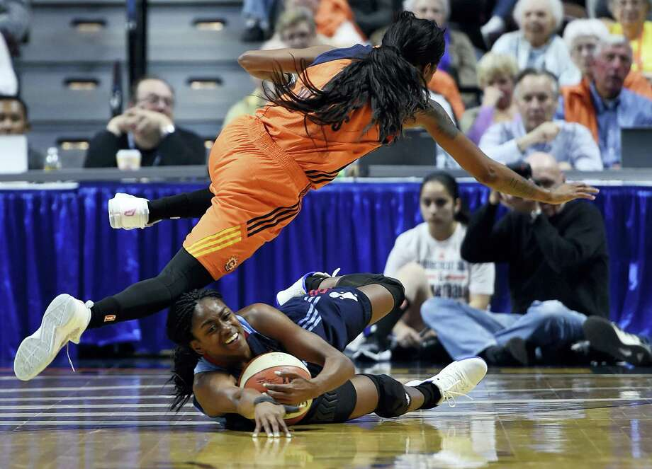 The Sun's Courtney Williams, top, fouls the Dream's Tiffany Hayes during the first half Saturday. Photo: Sean D. Elliot — The Day Via AP  / 2017 The Day Publishing Company