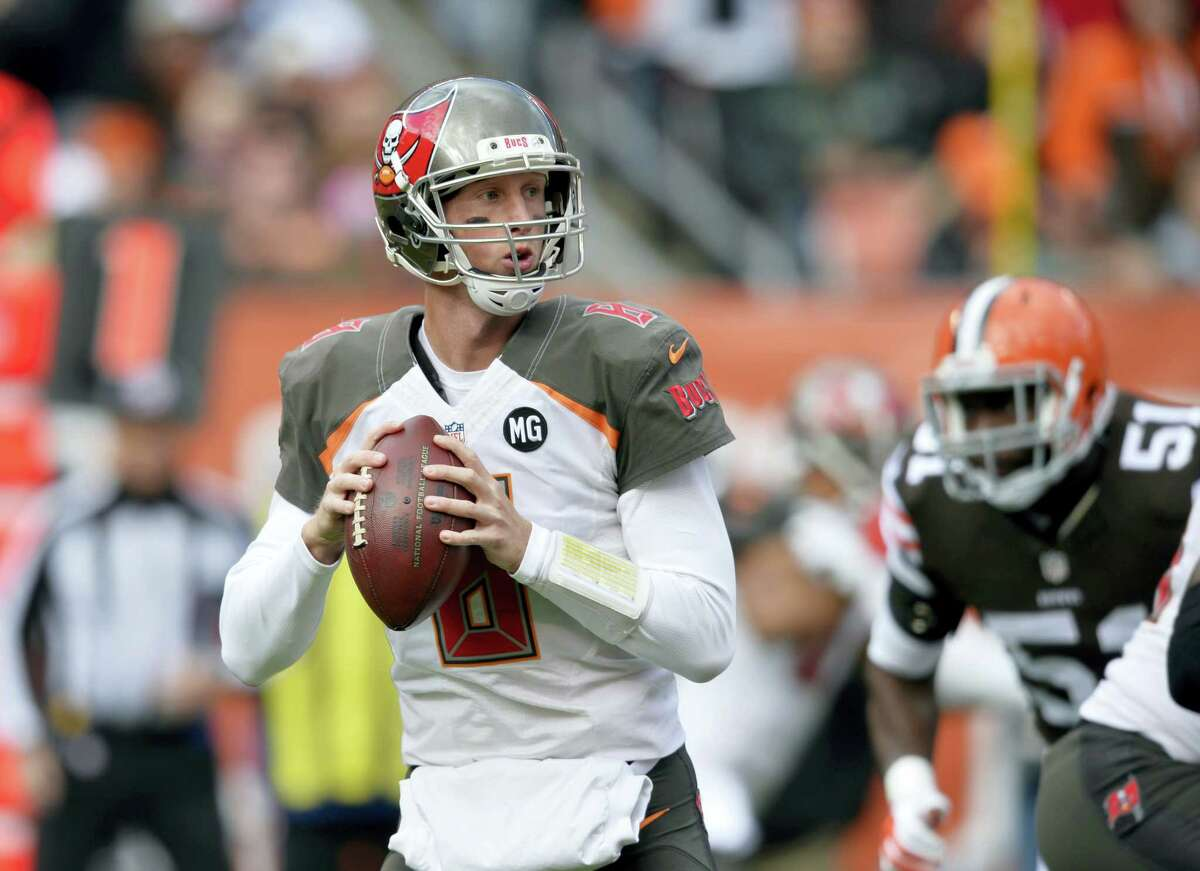 In this Nov. 2, 2014 photo, Tampa Bay Buccaneers quarterback Mike Glennon looks to pass against the Cleveland Browns in the first quarter of an NFL football game in Cleveland. With backups quarterbacks like Glennon, Jimmy Garoppolo, A.J. McCarron and Colt McCoy possibly on the move this offseason, the task for talent evaluators will be figuring out which group best fits each quarterback.