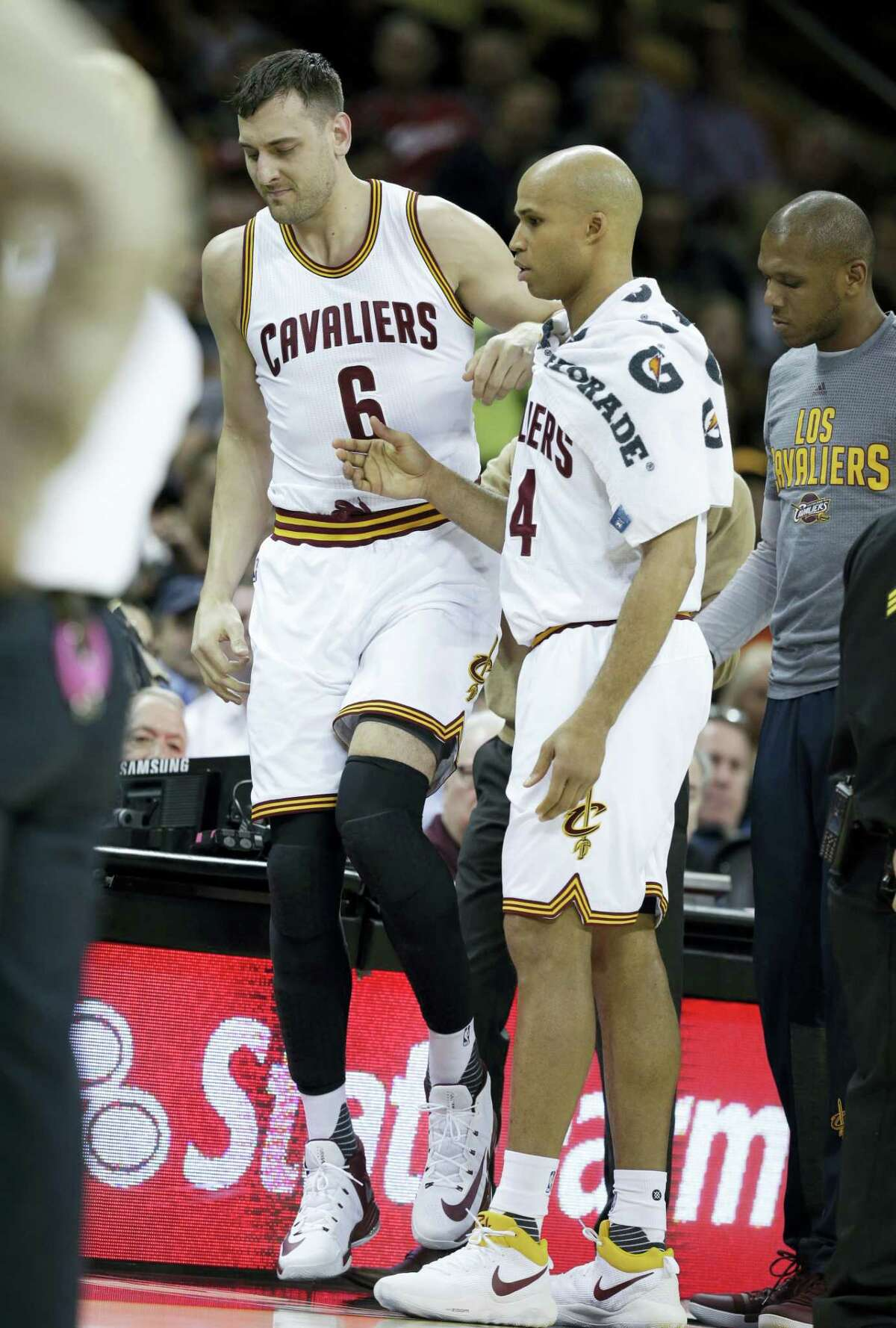 Cleveland Cavaliers' Andrew Bogut (6) is helped up by Cleveland Cavaliers' Richard Jefferson (24) in the first half of an NBA basketball game against the Miami Heat on March 6, 2017 in Cleveland. Initial X-rays and evaluation of Bogut revealed a fractured left tibia. The Heat won 106-98.