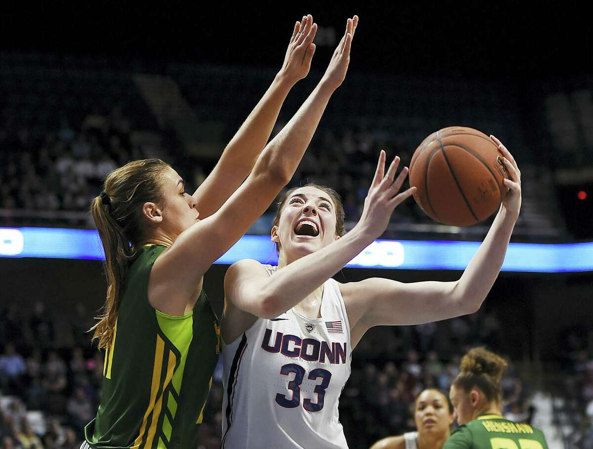 UConn's Katie Lou Samuelson shoots over South Florida's Ariadna Pujol during the first half .