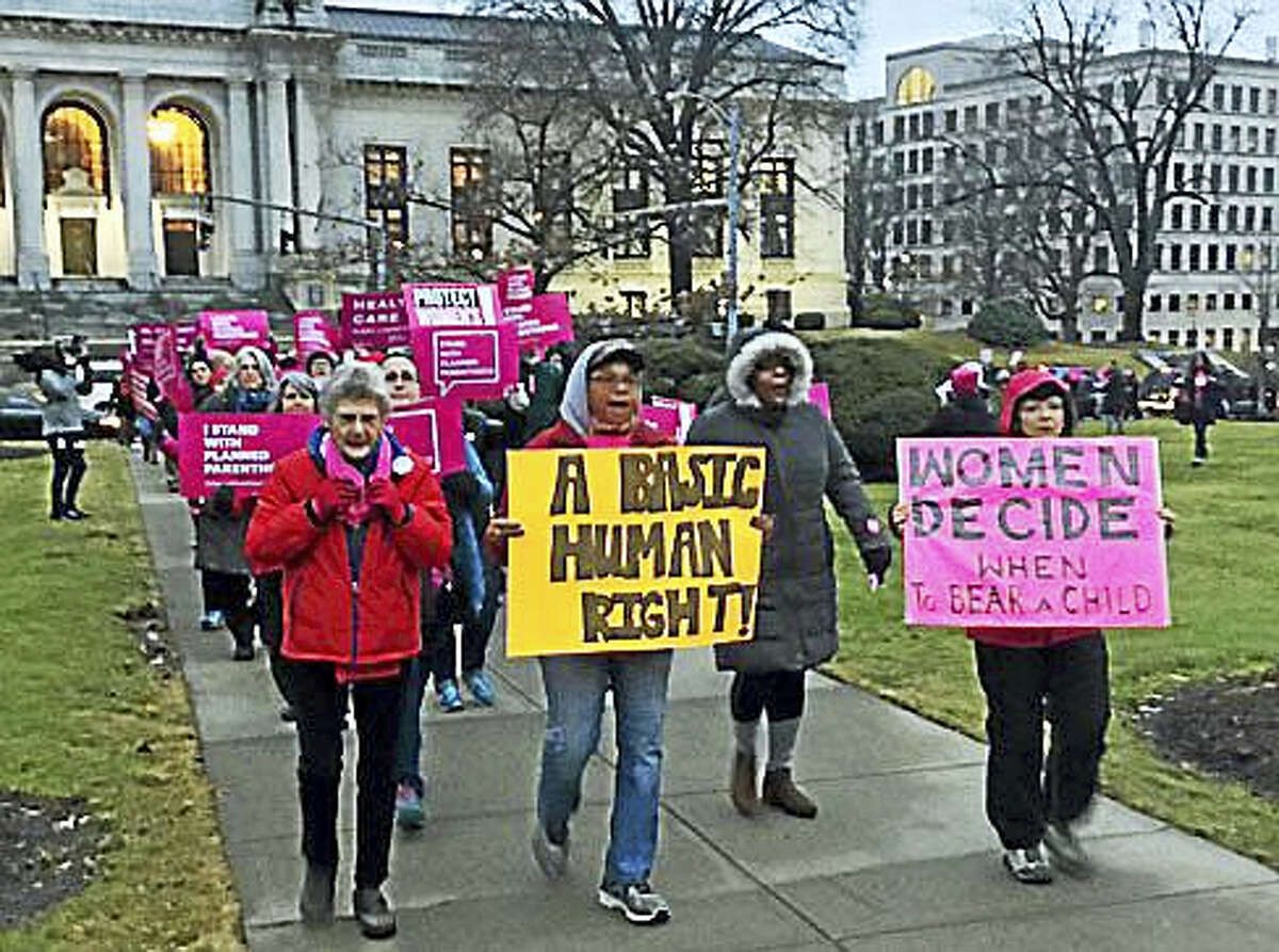 People rally in Hartford on Wednesday