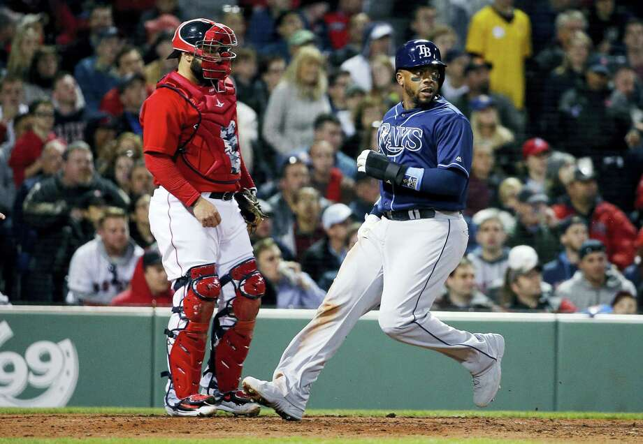 The Rays' Rickie Weeks, right, looks back as he crosses home plate in front of Sandy Leon on a two-run single by Tim Beckham in the fourth inning Friday. Photo: Michael Dwyer — The Associated Press  / Copyright 2017 The Associated Press. All rights reserved.