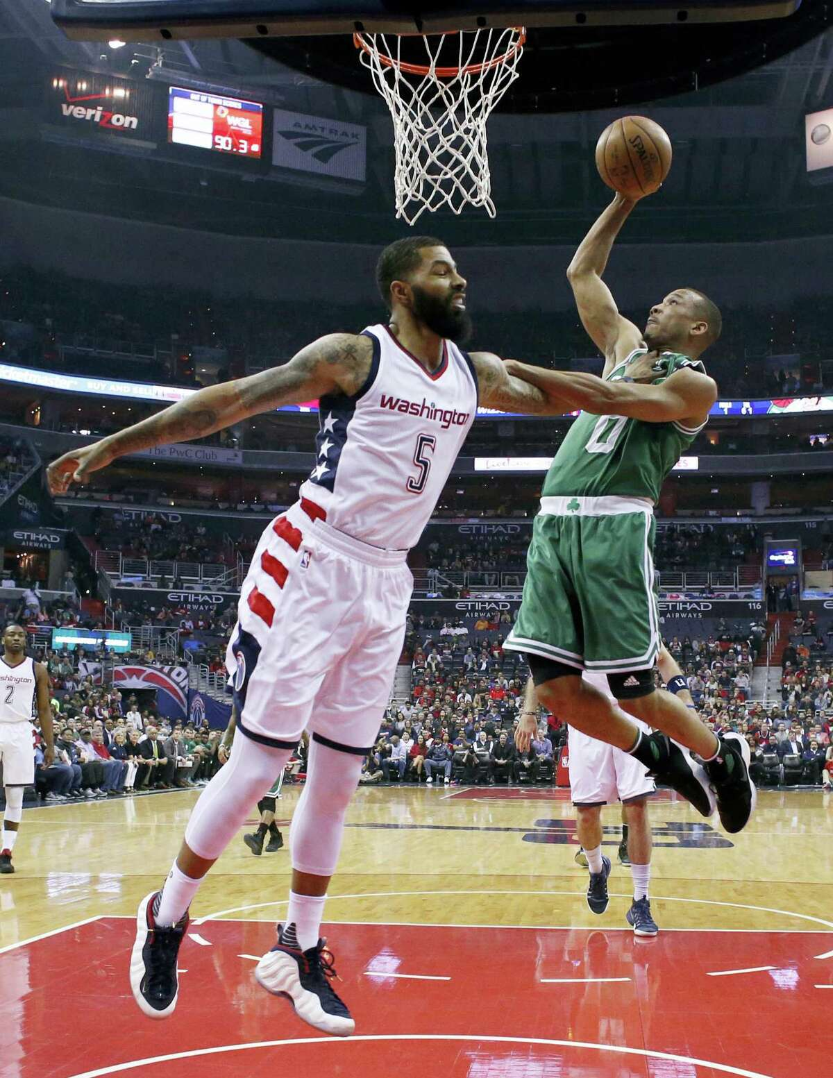 Celtics guard Avery Bradley, right, shoots over Wizards forward Markieff Morris during the first half Friday.