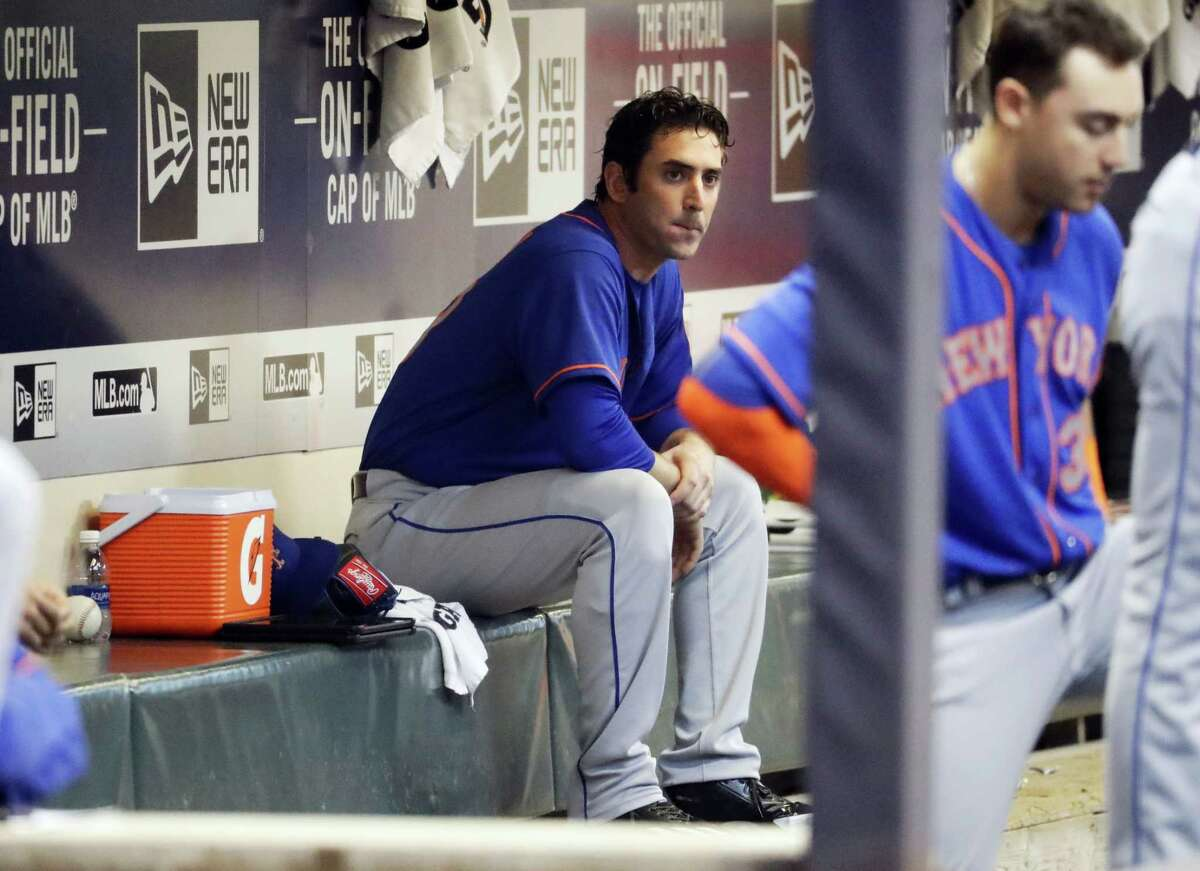 Mets starting pitcher Matt Harvey sits in the dugout Friday.