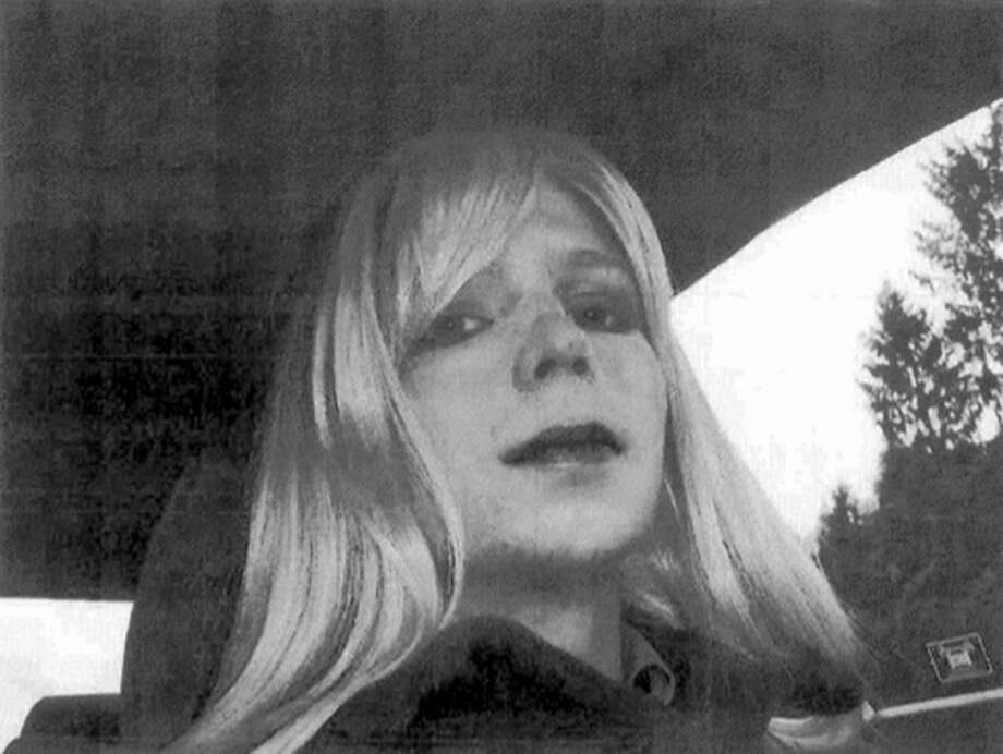 Chelsea Manning poses for a photo wearing a wig and lipstick. On Tuesday, Jan. 17, 2017, President Barack Obama commuted the sentence of Chelsea Manning, who leaked Army documents and is serving 35 years. Photo: U.S. Army Via AP, File / U.S. Army