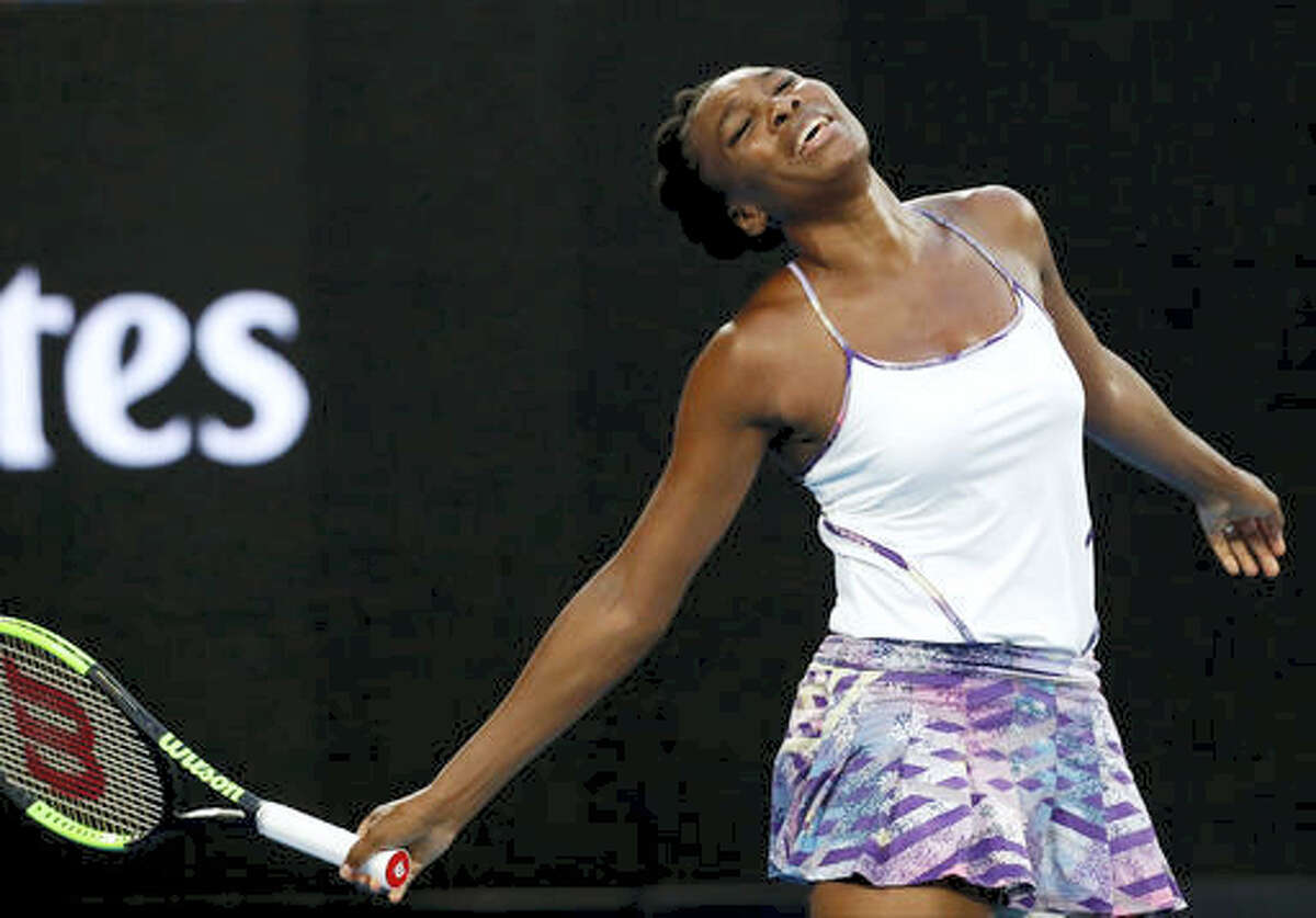 In this Jan. 28, 2017 photo, United States' Venus Williams reacts after missing a shot against sister Serena during the women's singles final at the Australian Open tennis championships in Melbourne, Australia. Williams will show off her spring tennis clothing line at Madison Square Garden. The EleVen by Venus collection will be worn by ball girls and ushers at the BNP Paribas Showdown on Monday, March 6. Williams will also play French Open champion Garbine Muguruza in the exhibition.