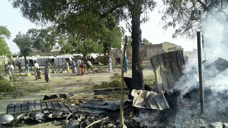 In this image supplied by MSF, smoke rises from a burnt out shelter at a camp for displaced people in Rann, Nigeria, Tuesday Jan. 17, 2017. Photo: Medecins Sans Frontieres (MSF) Via AP / MSF