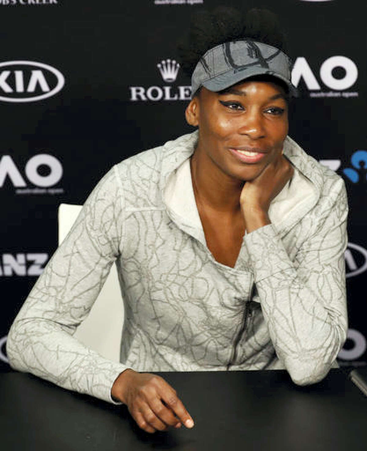 In this Jan. 28, 2017 photo, United States' Venus Williams answers a question at a press conference following her loss to sister Serena in the women's singles final at the Australian Open tennis championships in Melbourne, Australia. Williams will show off her spring tennis clothing line at Madison Square Garden. The EleVen by Venus collection will be worn by ball girls and ushers at the BNP Paribas Showdown on Monday, March 6. Williams will also play French Open champion Garbine Muguruza in the exhibition.