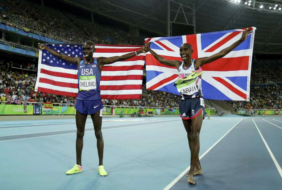 This is an Aug. 20, 2016 photo of Britain's gold medal winner Mo Farah, right, as he celebrates with United States' Paul Kipkemoi Chelimo, silver medalist, after  the 5,000 metres at the 2016 Summer Olympics in the Olympic stadium in Rio de Janeiro, Brazil. American and British Olympic leaders will firm up plans for a multisport event between the countries at a meeting in New York in March 2017. Photo: AP Photo — Matt Slocum/File  / Copyright 2016 The Associated Press. All rights reserved. This material may not be published, broadcast, rewritten or redistribu