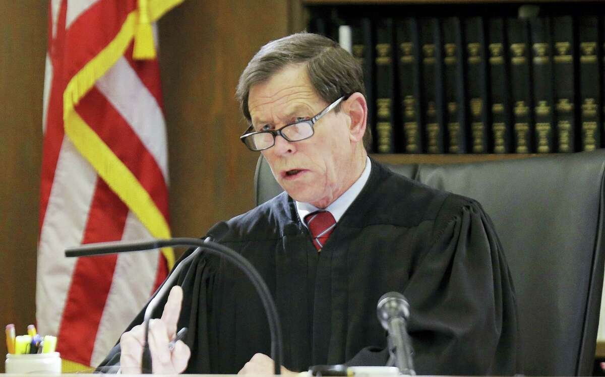 Judge Jeffrey Locke questions defense attorney Ronald Sullivan as he argues the merits of a defense motion with Locke during former New England Patriots tight end Aaron Hernandez double murder trial at Suffolk Superior Court on March 6, 2017 in Boston. Hernandez is standing trial for the July 2012 killings of Daniel de Abreu and Safiro Furtado who he encountered in a Boston nightclub. The former NFL player is already serving a life sentence in the 2013 killing of semi-professional football player Odin Lloyd.