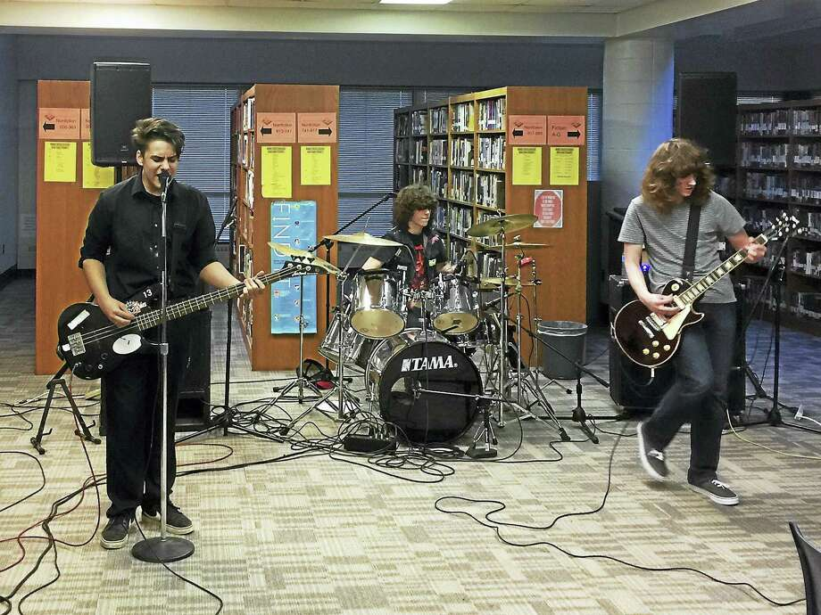 American Amnesia, seen performing at the Oliver Wolcott Tech art show Thursday in Torrington. From left: Tate Simmons, Sam Cesnak and Patrick Nemaizer. Photo: Ben Lambert — The Register Citizen