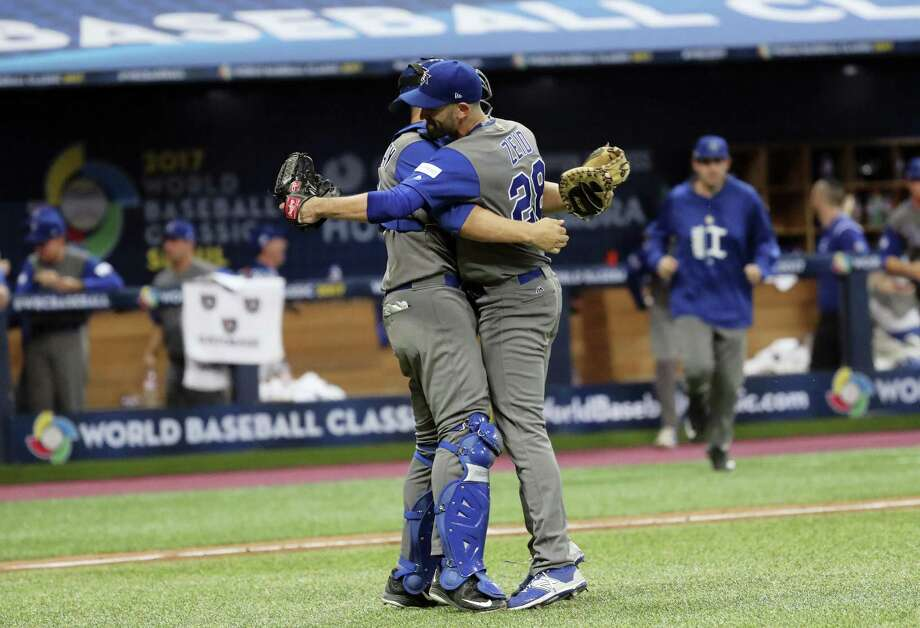 Israel pitcher Josh Zeid, right, celebrates his team's victory over South Korea with catcher Ryan Lavarnway at the World Baseball Classic in Seoul, South Korea, on Monday. Photo: Lee Jin-man — The Associated Press  / Copyright 2017 The Associated Press. All rights reserved.