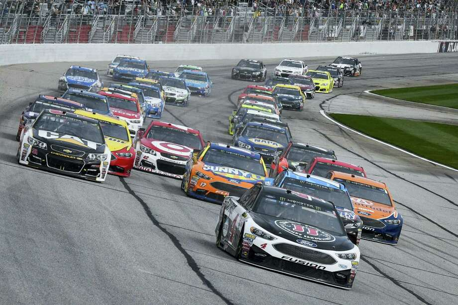 Kevin Harvick leads off the start during Sunday's race at Atlanta Motor Speedway. Photo: John Amis — The Associated Press  / FR69715 AP