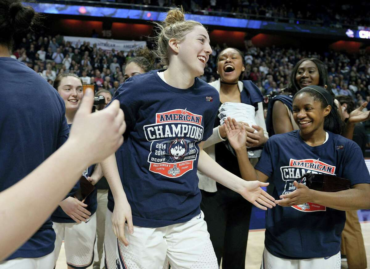 UConn's Katie Lou Samuelson, center, is cheered on by her teammates after she was announced as the Most Outstanding Player for the AAC tournament on Monday at Mohegan Sun Arena in Uncasville.