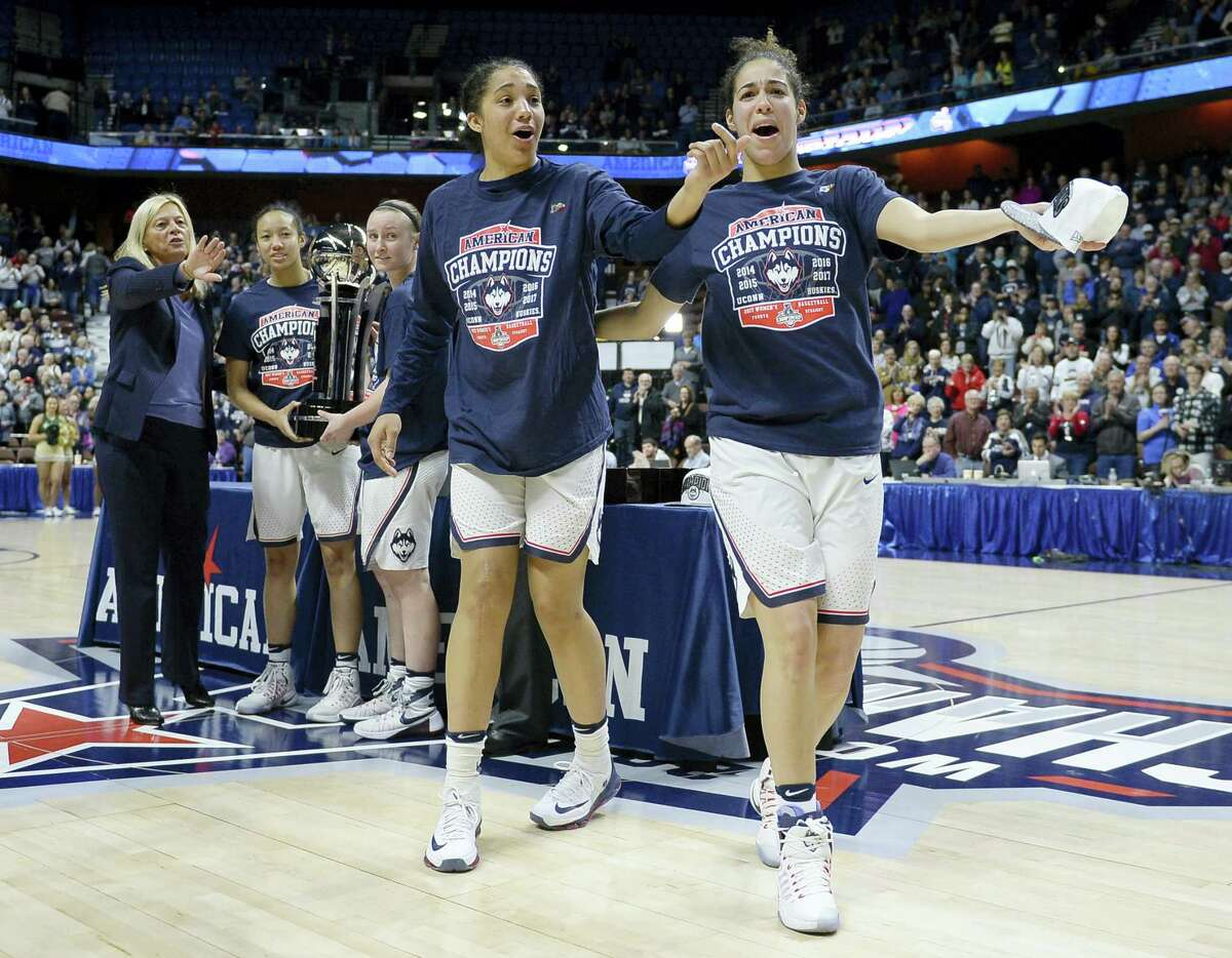 UConn's Gabby Williams and Kia Nurse playfully react during Monday's AAC championship trophy ceremony.