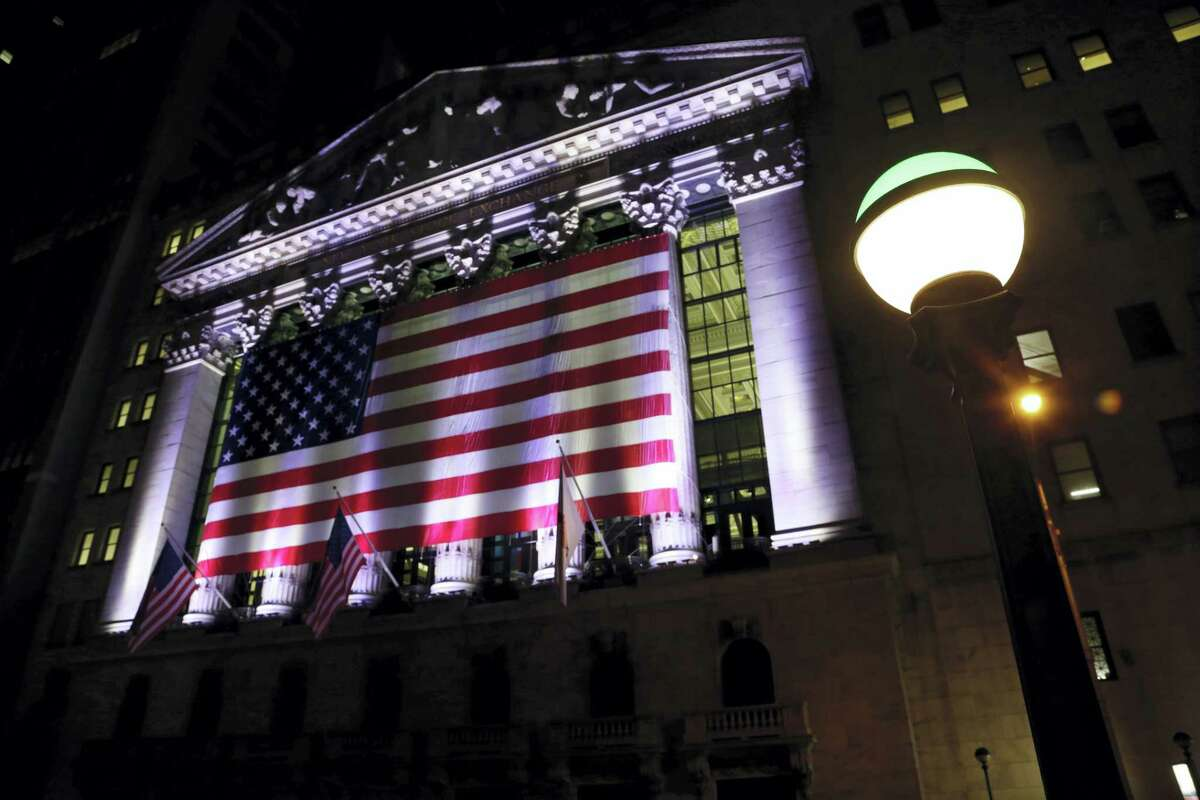 An American flag hangs on the front of the New York Stock Exchange.