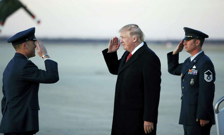 President Donald Trump salutes as he stands on the tarmac after disembarking Air Force One as he arrives on March 5, 2017 at Andrews Air Force Base, Md. Trump is returning from Mar-a-Largo, Fla. Photo: AP Photo — Alex Brandon  / Copyright 2017 The Associated Press. All rights reserved.
