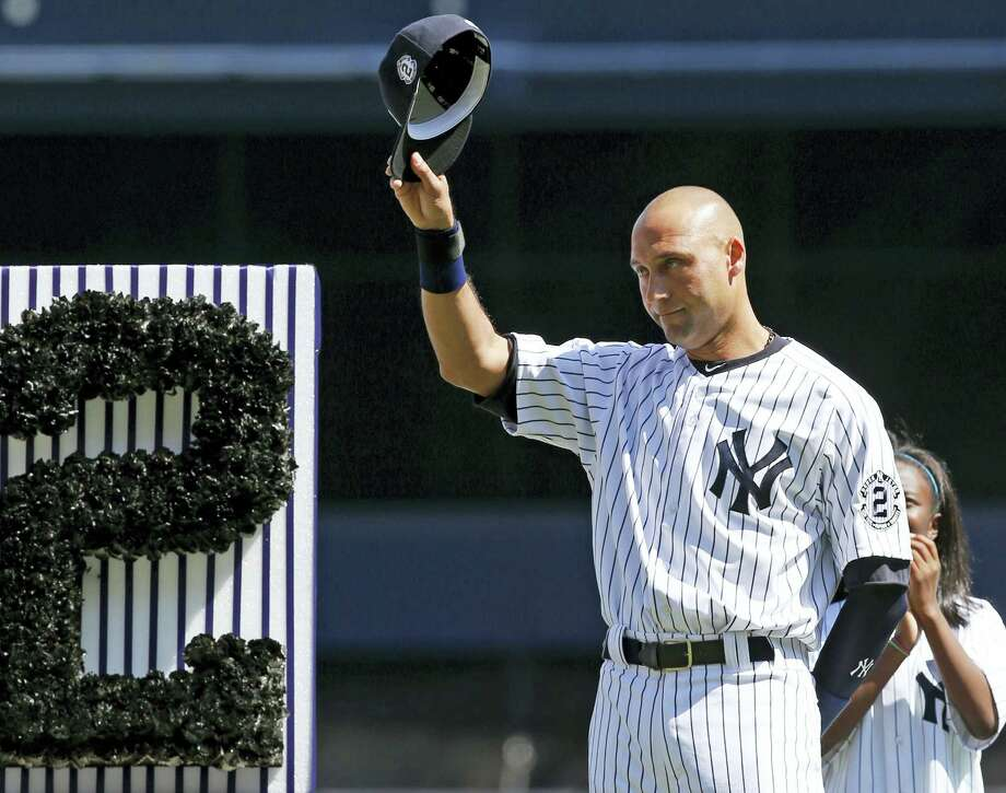 In this Sept. 7, 2014 photo, New York Yankees' Derek Jeter (2) tips his cap to fans during a pregame ceremony honoring the Yankees captain. Jeter wrote an essay published May 11, 2017 on his Players' Tribune site thanking the city before his No. 2 jersey is permanently retired by the team on May 14. Photo: AP Photo — Kathy Willens, File  / Copyright 2017 The Associated Press. All rights reserved.