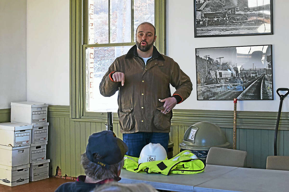 O&G's safety director Mike Ferry speaks with volunteers at the Railroad Museum of New England in Thomaston.