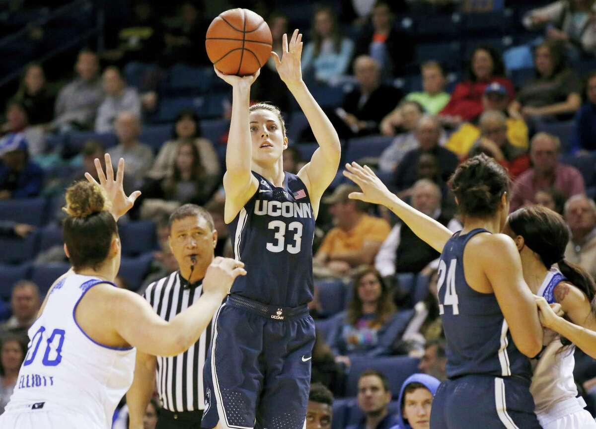 UConn's Katie Lou Samuelson (33) shoots in front of Tulsa forward Kendrian Elliott (00), UConn's Napheesa Collier (24) and Tulsa's Ebony Parker, right, during the first quarter of UConn's 98-58 win.