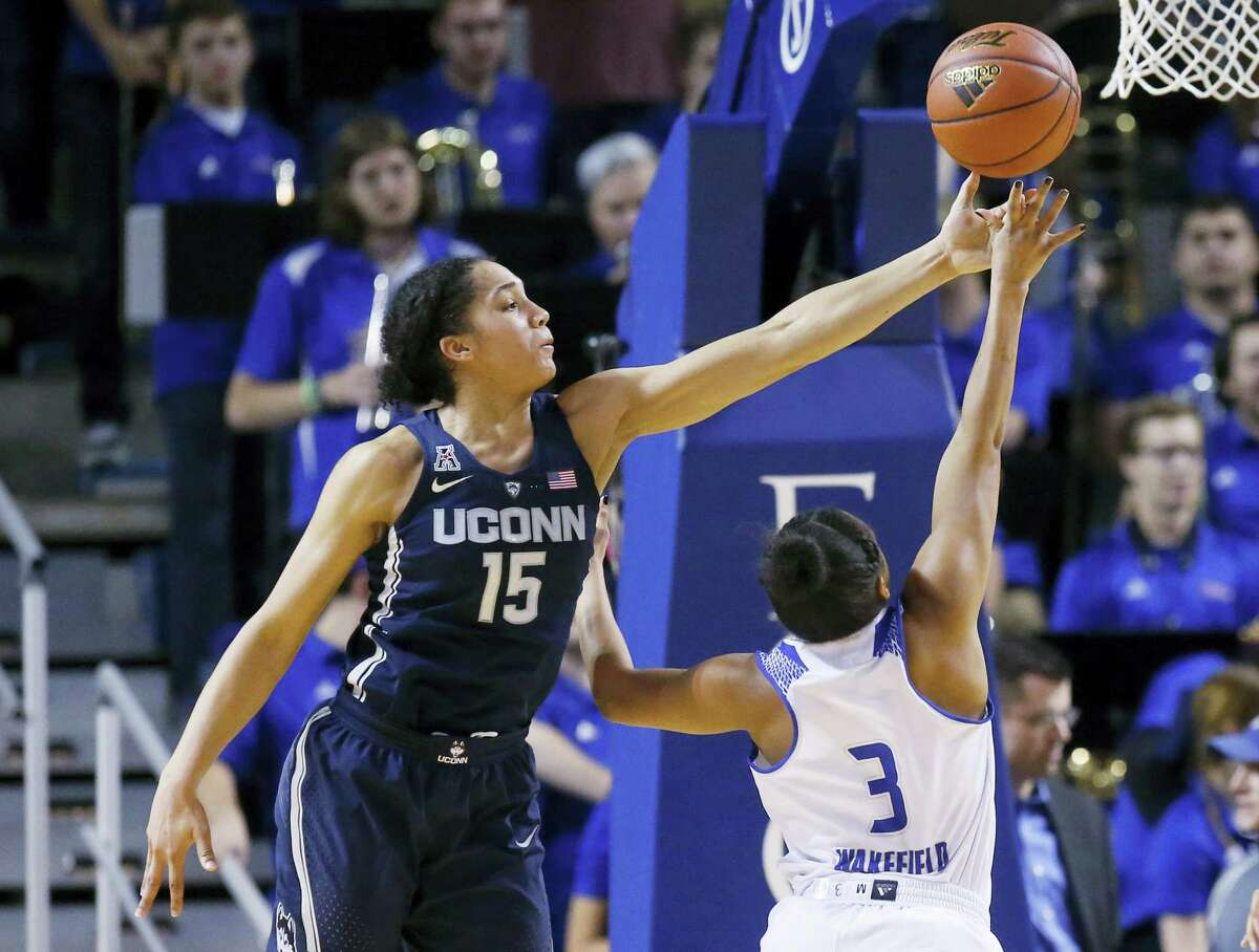 UConn guard Gabby Williams reaches up to block a shot by Tulsa guard Erika Wakefield (3) during the second quarter. UConn won 98-58.