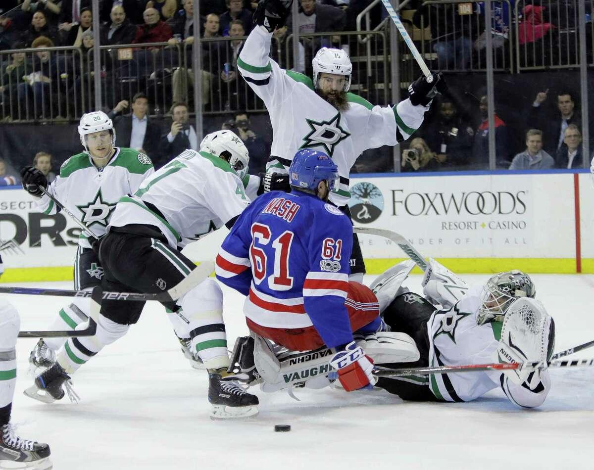 Dallas Stars' Patrik Nemeth (15) knocks down New York Rangers' Rick Nash (61) as goalie Antti Niemi (31) watches during the second period of the Stars' 7-6 win Tuesday night.