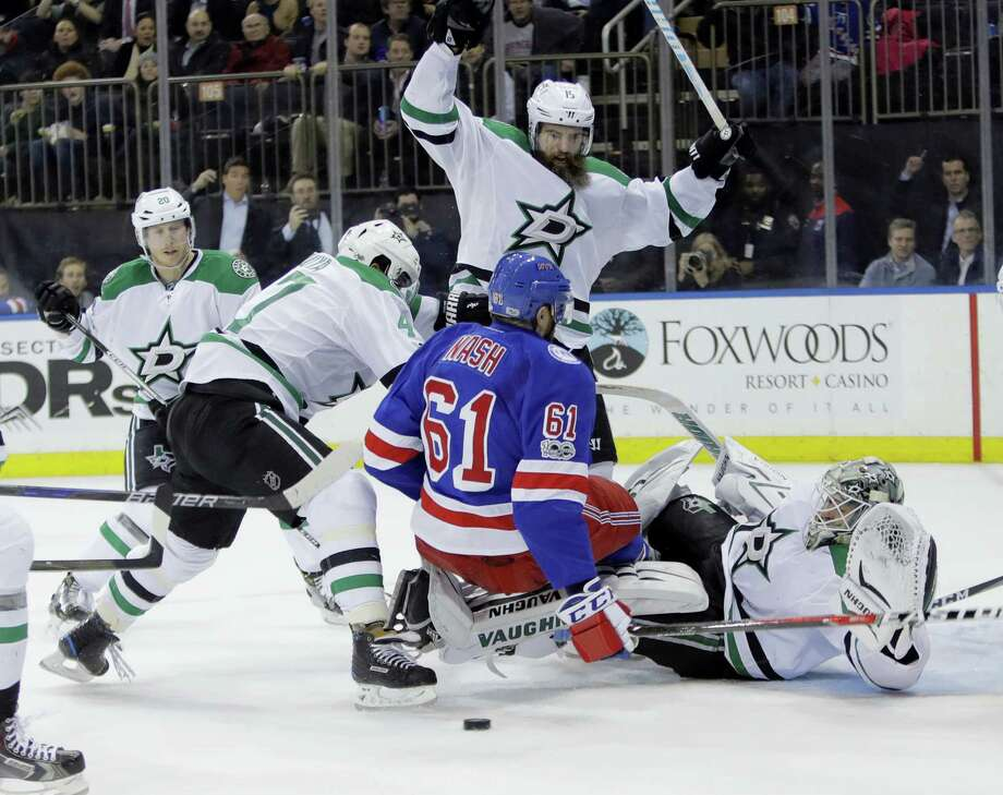 Dallas Stars' Patrik Nemeth (15) knocks down New York Rangers' Rick Nash (61) as goalie Antti Niemi (31) watches during the second period of the Stars' 7-6 win Tuesday night. Photo: FRANK FRANKLIN II — THE ASSOCIATED PRESS  / Copyright 2017 The Associated Press. All rights reserved.
