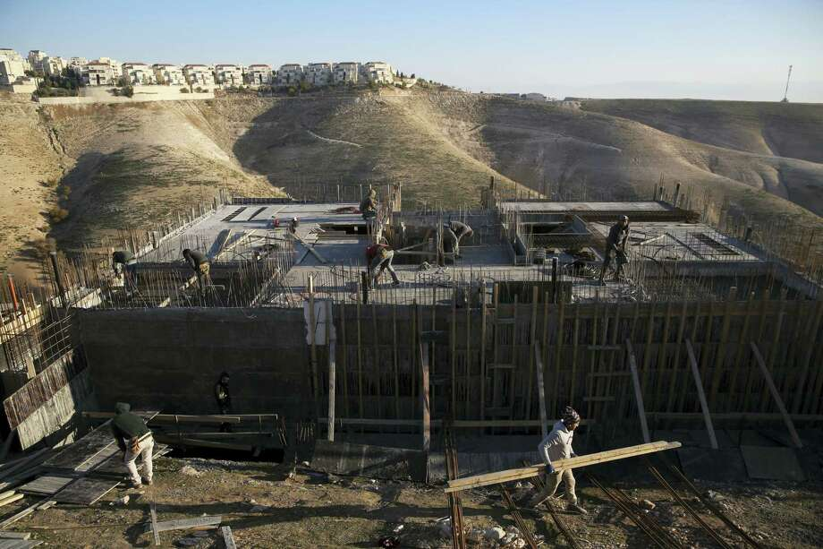 """This Feb. 7, 2017 photo shows Palestinian laborers work at a construction site in a new housing project in the Israeli settlement of Maale Adumim, near Jerusalem. Israel's defense minister says the U.S. has notified Israel that imposing Israeli sovereignty over the West Bank would lead to an """"immediate crisis"""" with the Trump administration. Defense Minister Avigdor Lieberman said March 6, 2017 that, """"We received a direct message — not an indirect message and not a hint — from the United States. Imposing Israeli sovereignty on Judea and Samaria would mean an immediate crisis with the new administration."""" Photo: AP Photo — Oded Balilty, File  / Copyright 2017 The Associated Press. All rights reserved."""