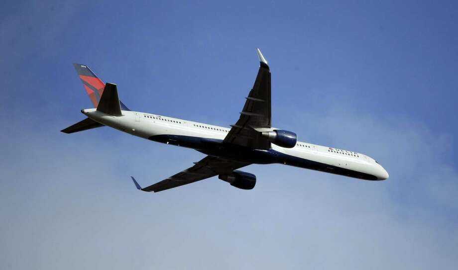 A Delta Air Lines Boeing 757 flies overhead in Seattle. Photo: Ted S. Warren — AP File Photo  / Copyright 2016 The Associated Press. All rights reserved. This material may not be published, broadcast, rewritten or redistribu