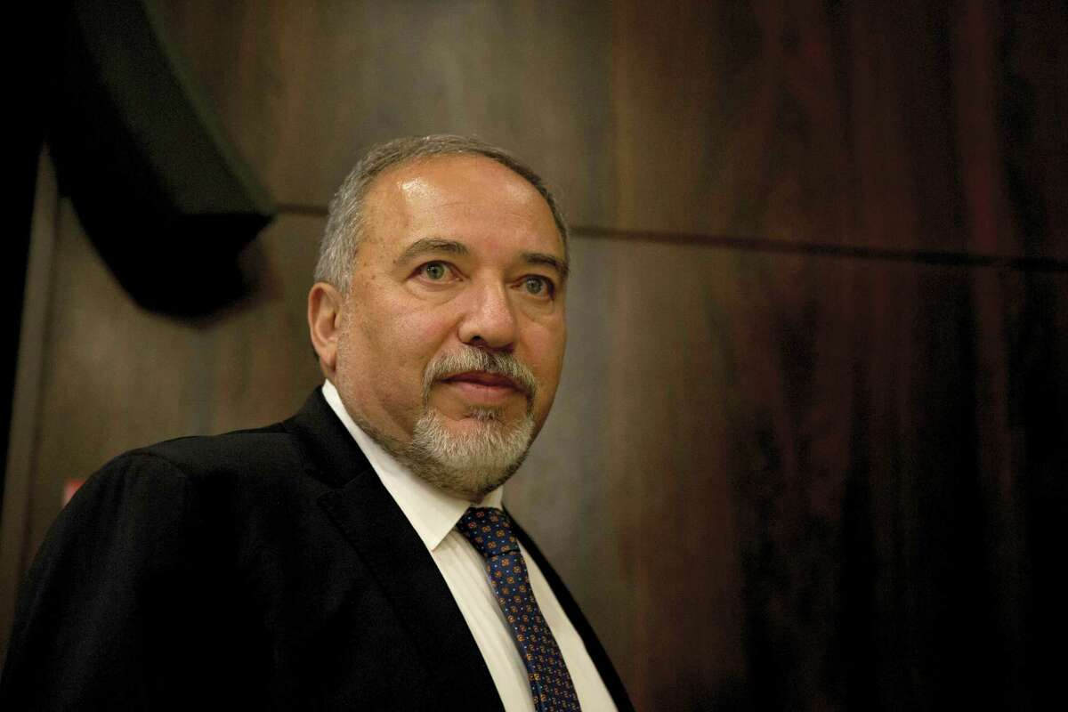 """In this May 30, 2016 photo, Israeli Defense Minister Avigdor Lieberman appears at the Knesset, Israel's parliament, before his swearing-in ceremony, in Jerusalem. Lieberman said March 6, 2017 that the U.S. notified Israel that imposing Israeli sovereignty over the West Bank would lead to an """"immediate crisis"""" with the Trump administration. Lieberman said: """"We received a direct message -- not an indirect message and not a hint -- from the United States. Imposing Israeli sovereignty on Judea and Samaria would mean an immediate crisis with the new administration."""" Judea and Samaria is the biblical term for the West Bank."""