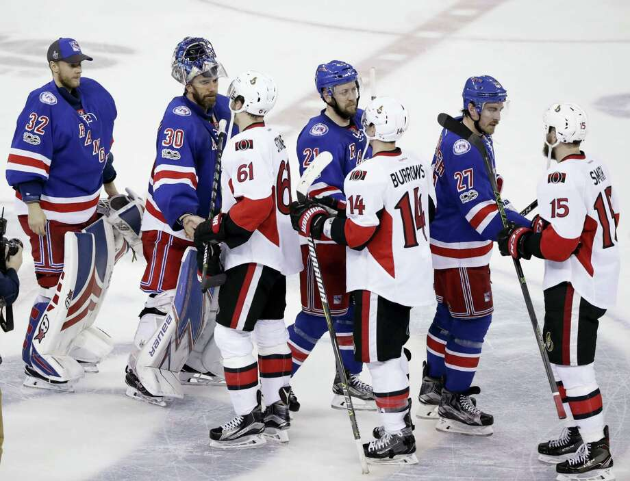 Members of the Rangers shake hands with members of the Senators after Game 6 of their playoff season.. Photo: The Associated Press File Photo  / Copyright 2017 The Associated Press. All rights reserved.