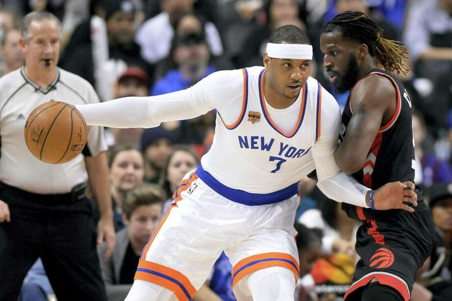 New York Knicks forward Carmelo Anthony (7) leans in  against Toronto Raptors forward DeMarre Carroll during first-half NBA basketball game action in Toronto on Jan. 15, 2017. Photo: Frank Gunn/The Canadian Press Via AP  / The Canadian Press