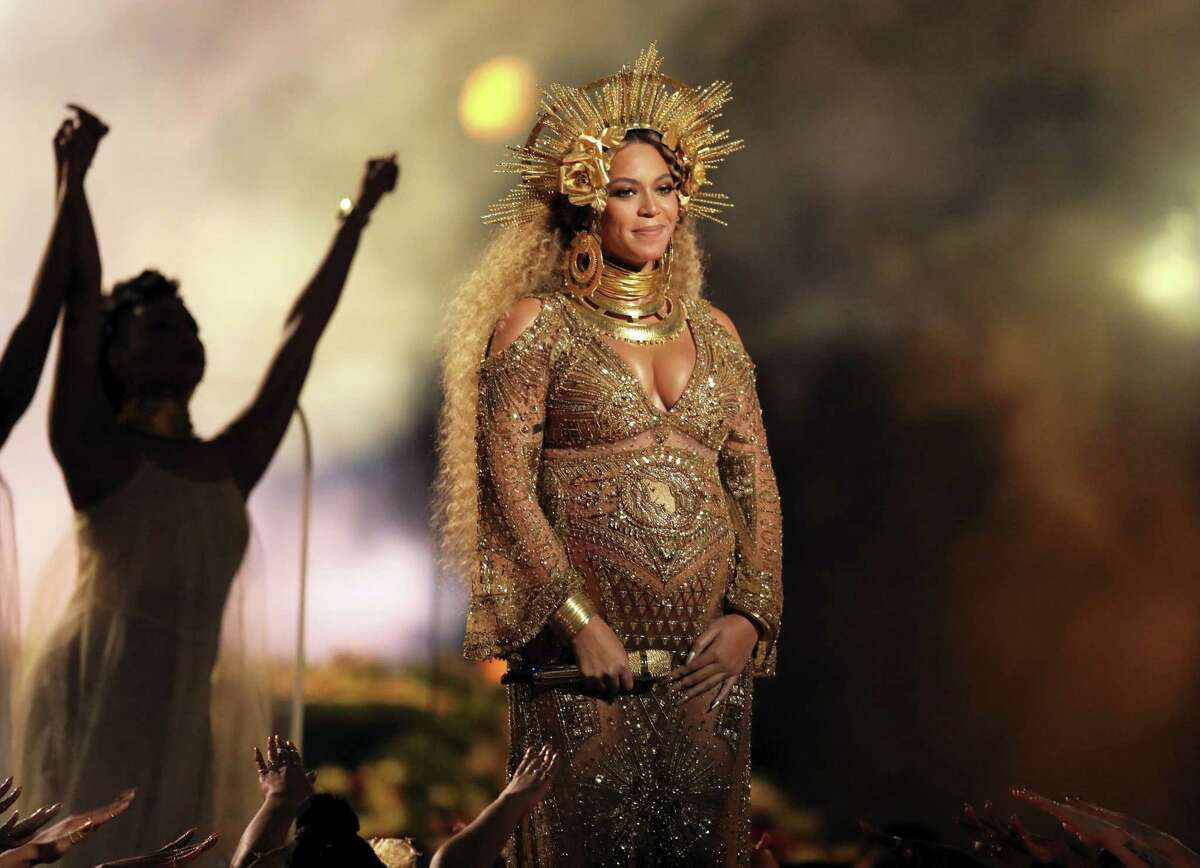 This Feb. 12, 2017 photo shows Beyonce performing at the 59th annual Grammy Awards in Los Angeles. Beyonce shared photos of her growing baby bump on her website on March 6, 2017. She and husband Jay Z are expecting twins.