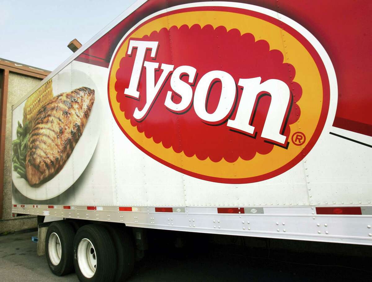 In this Oct. 28, 2009, file photo, a Tyson Foods, Inc., truck is parked at a food warehouse in Little Rock, Ark. Tyson Foods said March 6, 2017, a strain of bird flu sickened chickens at a poultry breeder that supplies it with birds. The U.S. Department of Agriculture says the 73,500 birds at the Lincoln County, Tenn., facility were destroyed and none of the birds from the flock will enter the food system. The H7 strain of Highly Pathogenic Avian Influenza, or HPAI, can be deadly for chickens and turkeys.