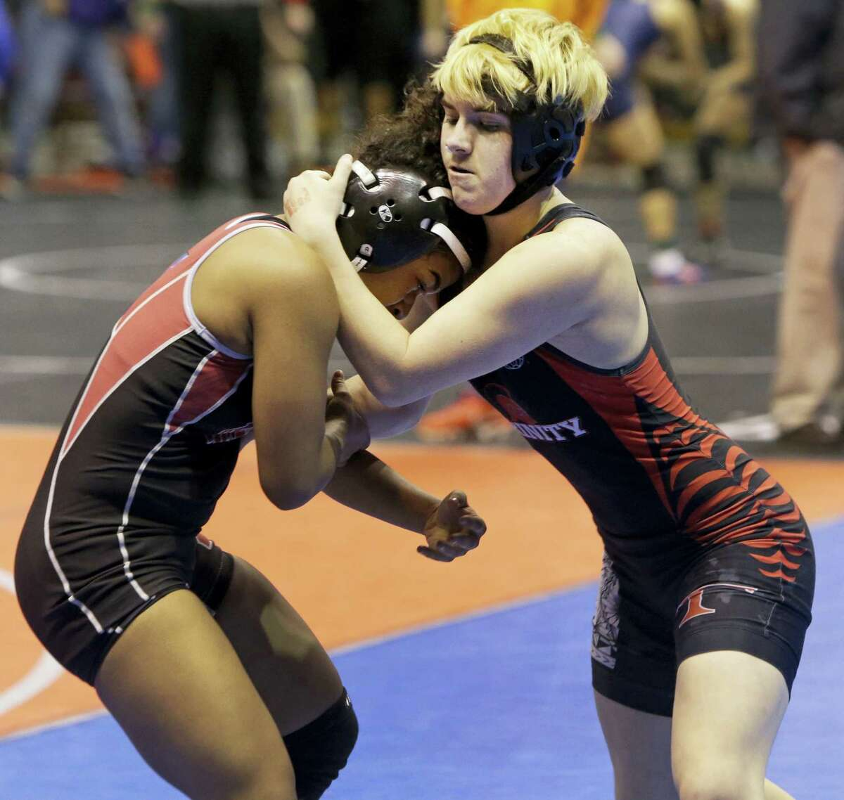 In this Friday, Feb. 24, 2017 photo, Mack Beggs, right, a transgender wrestler from Euless Trinity, competes in a quarterfinal against Mya Engert of Amarillo Tascosa during the state wrestling tournament in Cypress, Texas. Beggs, who won a girls wrestling state title in Texas, says he would compete against boys if allowed and is taking lower doses of testosterone to try to be fair to his opponents.