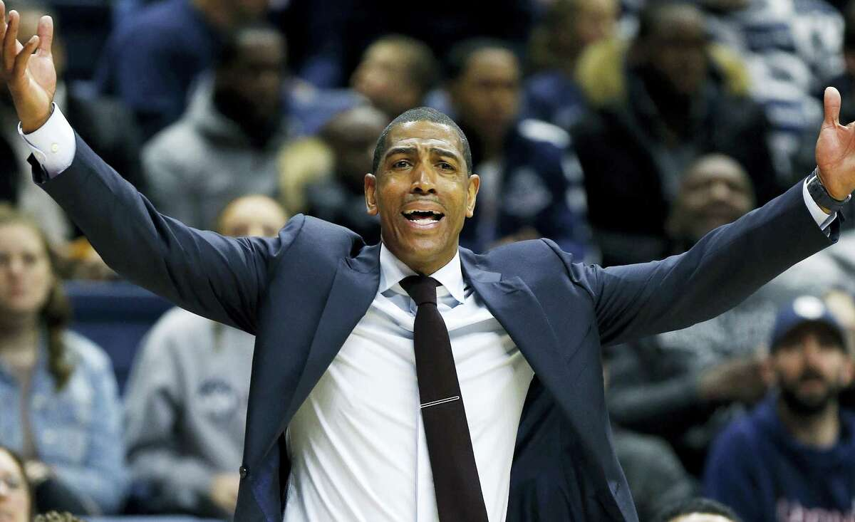UConn head coach Kevin Ollie reacts during the first half Sunday's game against Cincinnati in Storrs.