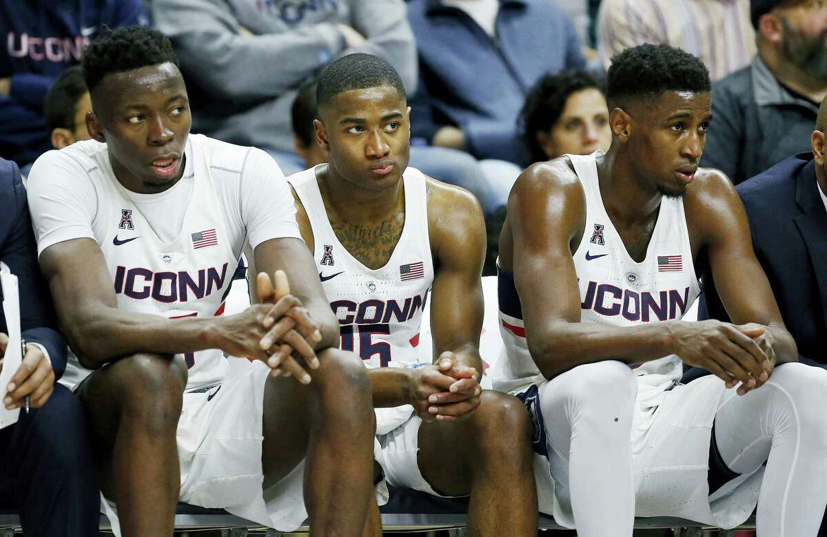 From left, UConn seniors Amida Brimah, Rodney Purvis and Kentan Facey watch from the bench during the second half against Cincinnati on Sunday.