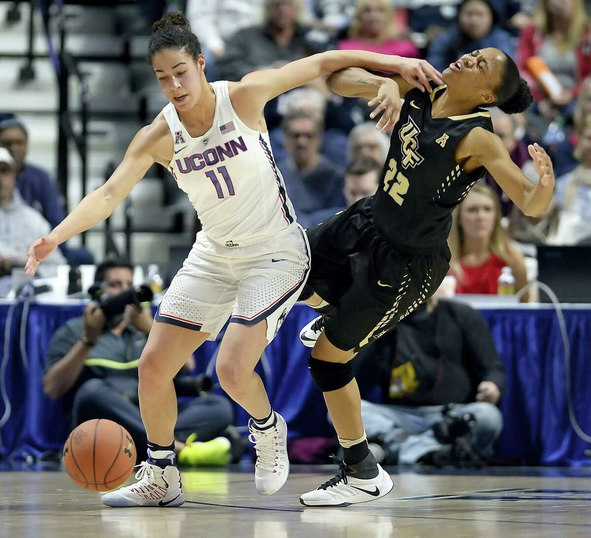 UConn's Kia Nurse, left, and Central Florida's Aliyah Gregory, right, battle for a loose ball during the first half Sunday in an AAC semifinal at Mohegan Sun Arena in Uncasville.