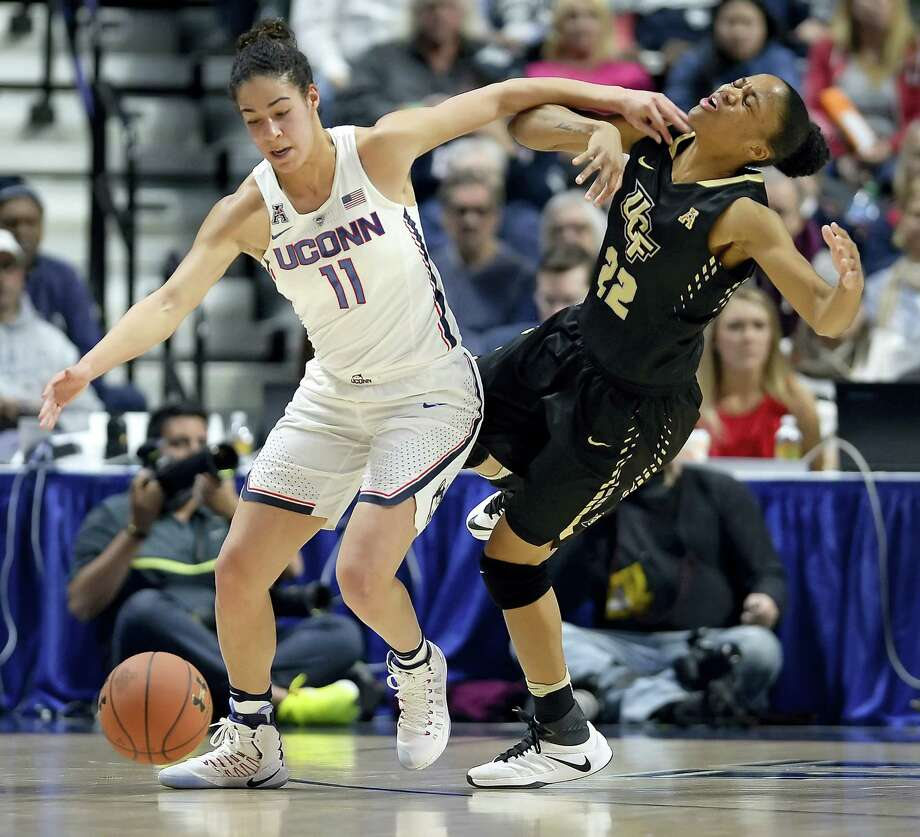 UConn's Kia Nurse, left, and Central Florida's Aliyah Gregory, right, battle for a loose ball during the first half Sunday in an AAC semifinal at Mohegan Sun Arena in Uncasville. Photo: Jessica Hill — The Associated Press  / AP2017