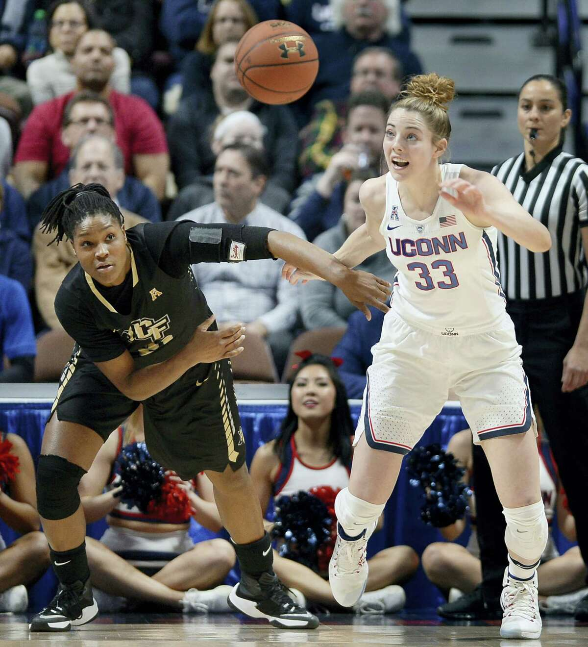 Central Florida's Joslyn Massey, left, and UConn's Katie Lou Samuelson, right, chase down a loose ball.