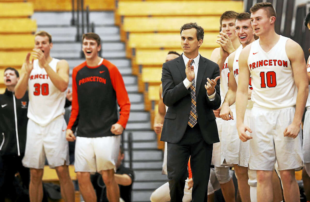 Princeton coach Mitch Henderson applauds as he stands with his players during the second half of an NCAA college basketball game against Rowan on Friday, Nov. 25, 2016, in Princeton, N.J. (AP Photo/Mel Evans)