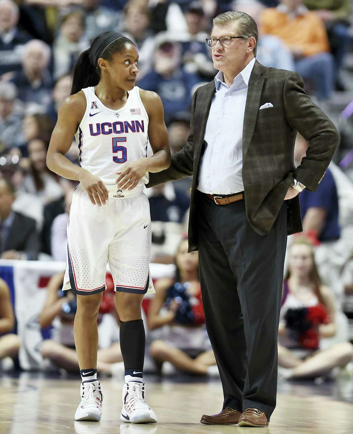 UConn head coach Geno Auriemma, right, talks with Crystal Dangerfield during Sunday's AAC semifinal.