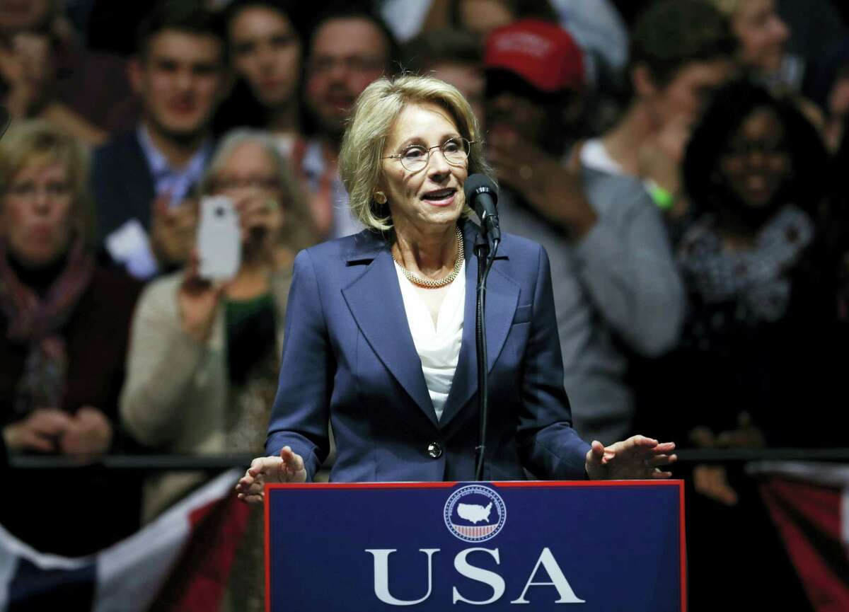 In this Dec. 9, 2016 photo, Education Secretary-designate Betsy DeVos speaks in Grand Rapids, Mich. Charter school advocate and wealthy Republican donor Betsy DeVos is widely expected to push for expanding school choice programs if confirmed as education secretary, causing outrage among teachers' unions. But Democrats and rights activists also are raising concerns about how her conservative Christian beliefs and advocacy for family values might impact minority and LGBT students.