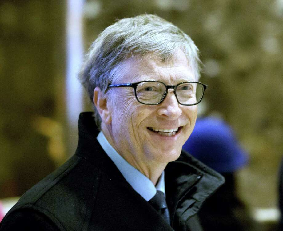 In this Dec. 13, 2016 photo, Bill Gates arrives to Trump Tower in New York. The eight individuals who own as much as half of the rest of the planet are all men, and have largely made their fortunes in technology. Gates co-founded Microsoft in the mid-70s, growing it into the world's biggest software company and helping to make computers a household item. Photo: AP Photo/Seth Wenig, File  / Copyright 2016 The Associated Press. All rights reserved.