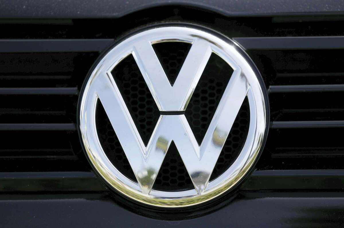 The Volkswagen logo on a car for sale at New Century Volkswagen dealership in Glendale.