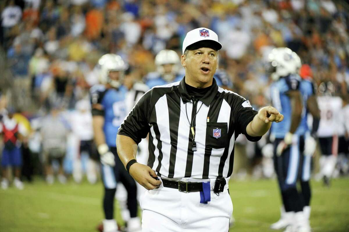 In this Aug. 27, 2011 photo, referee Alberto Riveron makes a call in the second quarter of an NFL football preseason game between the Chicago Bears and the Tennessee Titans in Nashville, Tenn. The NFL has promoted Riveron to its head of officiating. A nine-year game official and former referee, Riveron was born in Cuba.